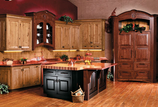 Country kitchen with rustic cabinets and hutch